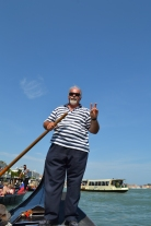 July 2013- My gondolier politely posed for a photo while we drifted through the streets of Venice, Italy. He had been a gondolier for over 20 years and claimed he enjoyed every moment. With working vacations taking place in other parts of Europe such as Holland and Germany.