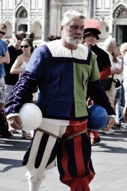 June 2013-A referee for Calcio Fiorentino or Calcio Storico (Historic Footbal) marches with the celebratory parade before the game. Calcio Fiorentino was established by the Medici as a game to keep the masses pleased and pit neighborhoods against one another. The game is known for its violence as men in Renaissance pants play a game of football meets rugby meets MMA fighting. My history teacher in Italy played when he was 19 and walked away with a broken ankle, a broken wrist, two broken collar bones, both eyes blackened, and several cracked ribs.